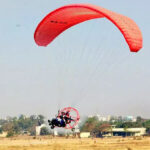 Thrilling Motorized Paragliding Experience 12